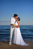 Bride and groom at the beach Stock Image