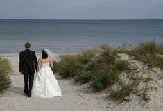 Bride and groom at the beach Stock Photos