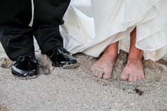 Bride and groom on beach Stock Photography