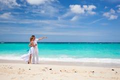 Bride and groom on beach Stock Photos