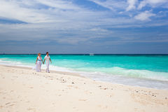 Bride and groom on beach stock images