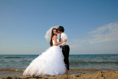 Bride and groom at the beach Stock Photography