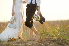 Bride and groom on a beach at sunset Royalty Free Stock Images