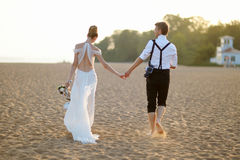 Bride and groom on a beach at sunset Royalty Free Stock Photo