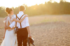 Bride and groom on a beach at sunset Royalty Free Stock Photos