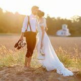 Bride and groom on a beach at sunset Stock Image