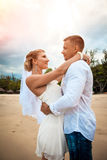 Bride and groom on the beach on their wedding day Royalty Free Stock Image