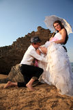 Bride and groom at the beach wedding Stock Photo
