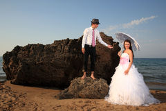 Bride and groom at the beach Stock Images