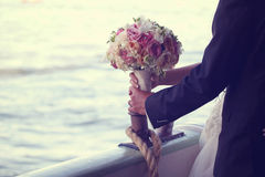 Bride and groom with beautiful bouquet Royalty Free Stock Image