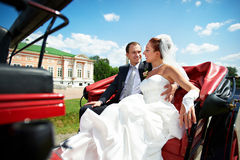 Bride and groom in beautiful carriage Royalty Free Stock Images