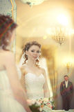 Bride and groom in  beautiful interior Stock Photography