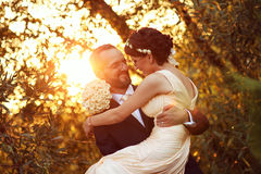 Bride and groom in a beautiful light holding hug Stock Photo