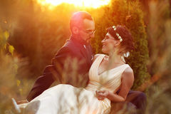 Bride and groom in a beautiful light holding hug Stock Images