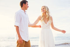 Bride and Groom, Beautiful Tropical Beach at Sunset, Romantic Ma Stock Image