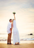 Bride and Groom, Beautiful Tropical Beach at Sunset, Romantic Ma Stock Images