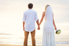 Bride and Groom, Beautiful Tropical Beach at Sunset, Romantic Ma Stock Photo