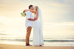 Bride and Groom, Beautiful Tropical Beach at Sunset, Romantic Ma Stock Photography