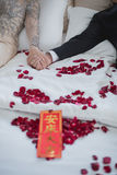 Bride and Groom on a Bed in Wedding Day, Asian culture Stock Photo