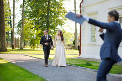 Bride and groom being greeted by their guests Royalty Free Stock Photography