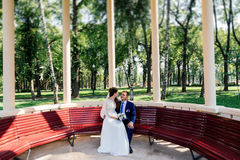 Bride and groom on a bench Stock Images