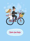 Bride and groom on a bicycle - Save The Date Royalty Free Stock Images