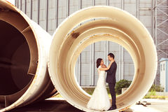 Bride and groom in a big pipe Stock Images