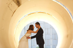 Bride and groom in a big pipe Stock Photo