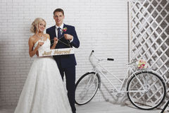 The bride and groom and the bike Royalty Free Stock Image
