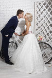 The bride and groom and the bike Stock Images