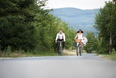 Bride and groom on the bikes Stock Image