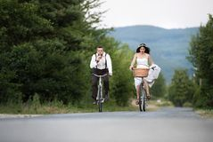 Bride and groom on the bikes Stock Photography