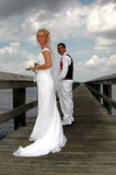 Bride and Groom on boardwalk. A bride and groom holding hands on  a boardwalk Royalty Free Stock Photo