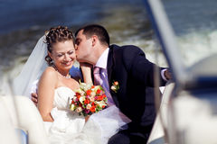 Bride and groom on the boat Royalty Free Stock Photography