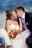 Bride and groom on the boat Royalty Free Stock Photos