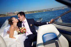 Bride and groom on the boat Royalty Free Stock Image