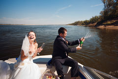 Bride and groom on the boat Stock Photo