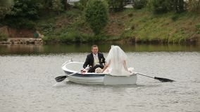 Bride And Groom In A Boat stock footage