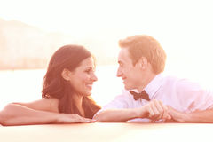 Bride and groom on a boat in Venice, loving each other sun. Lovely day wedding Stock Image