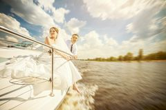 Bride and groom on the boat Stock Photos
