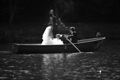 Bride, groom and boat Royalty Free Stock Photos
