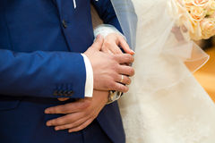 Bride and groom body parts with bouquet. Stock Images
