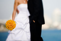 Bride and groom with bouquet stock photos