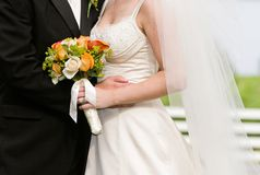 Bride, groom and bouquet. Wedding couple married with floral bouquet Royalty Free Stock Photo