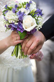Bride and groom with bouquet Stock Images