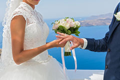 Bride and groom with a bouquet of flowers. Stock Photo