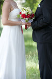 Bride and groom and bouquet Royalty Free Stock Photos