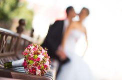 Bride and groom with bridal bouquet Royalty Free Stock Images
