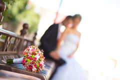 Bride and groom with bridal bouquet Stock Photo