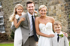 Bride And Groom With Bridesmaid And Page Boy At Wedding. Smiling To Camera royalty free stock images